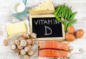 Quadro de ardósia e alimentos que contêm vitamina d